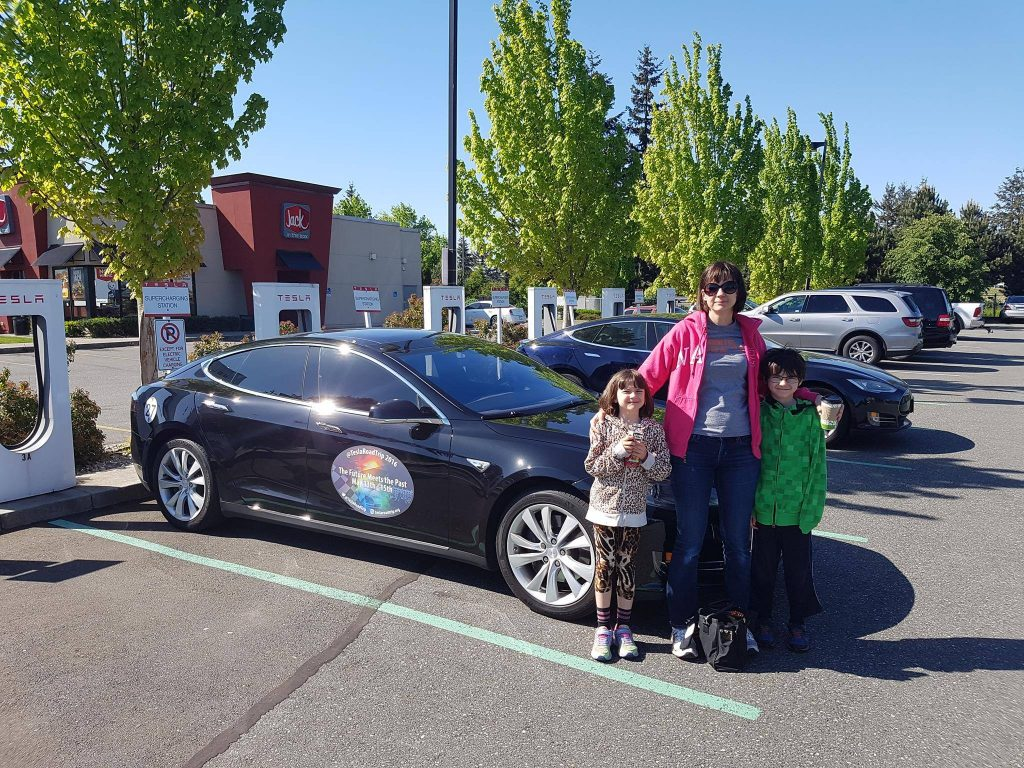 Lisa Locke and family at a SuperCharger