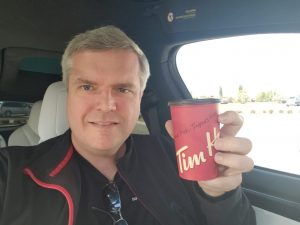 James and his Timmy's coffee after crossing into Canada